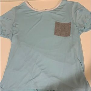 Blue t-shirt with pocket.